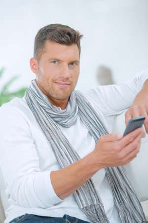 man holding a cellphone and posing