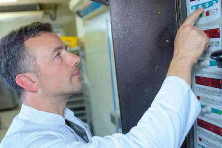 electromechanical: man pressing a machine