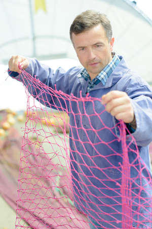inshore: fisherman checking the net