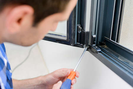 screwing: Screwing window frame Stock Photo