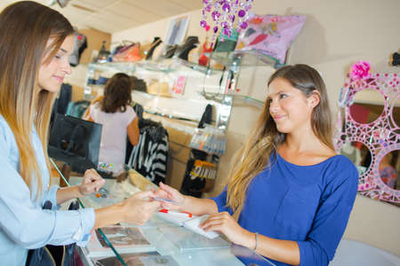 checkout: Lady at checkout, paying by credit card