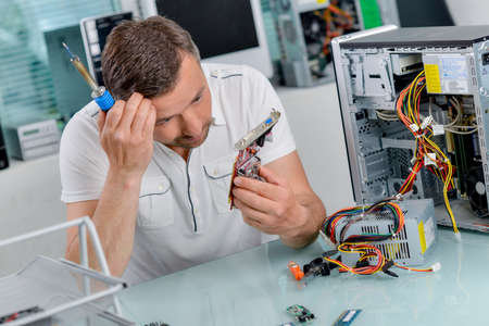 computer engineer: Whats wrong with this computer Stock Photo