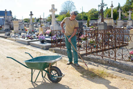 groundskeeper: groundskeeper in cemetery