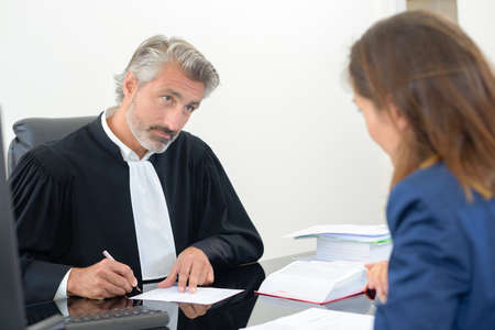distric: law staff with a client