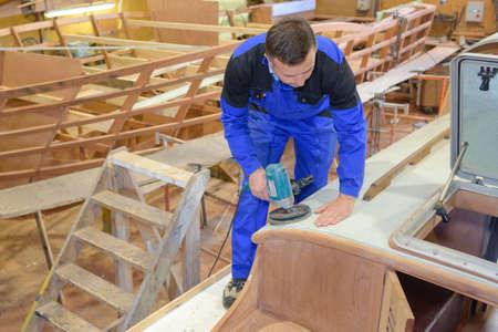 sander: Carpenter using sander
