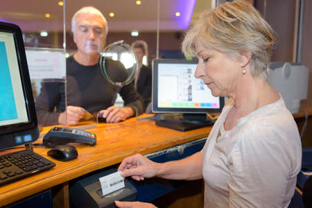 Man being served at ticket office