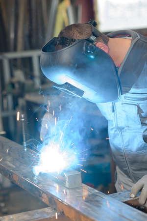 face work: Man welding