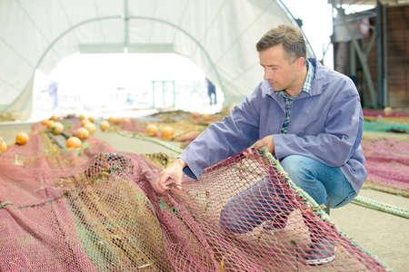 fixing: fixing the fishing net