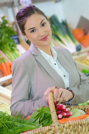 attractive woman in produce section of grocery store