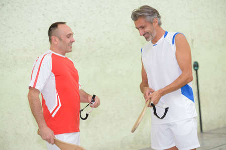 competitive sport: Sportsmen with wooden rackets