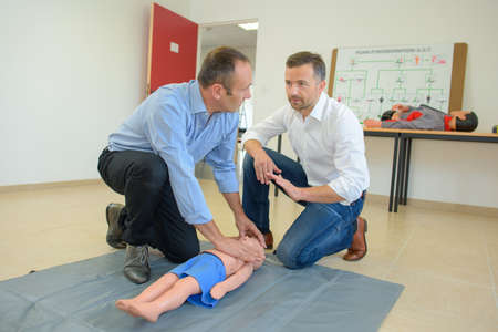 reanimate: Men at first aid course Stock Photo