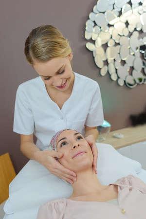 Beautician giving head massage