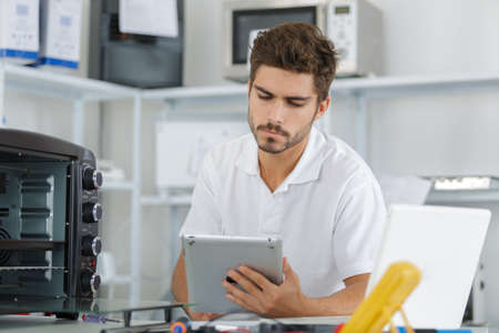 developement: attractive repairman concentrated at work Stock Photo