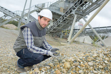 precast: worker holding a rock Stock Photo