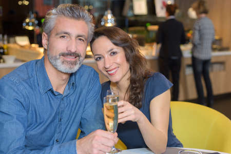 champain: couple in love celebrating their anniversary