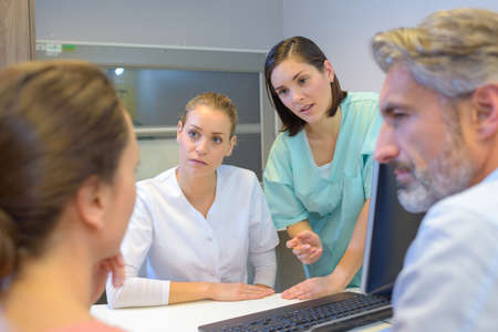 persuades: Medical staff talking to couple