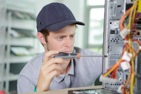 dismantle: Man working on tower computer Stock Photo