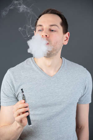 man smoking a controversial vaping an electronic cigarette