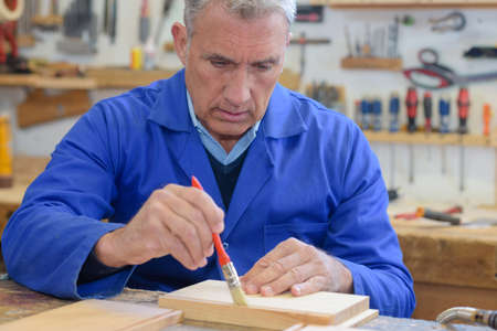 immersed: senior man working on his work bench
