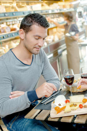 Man having meal, partner out of shot