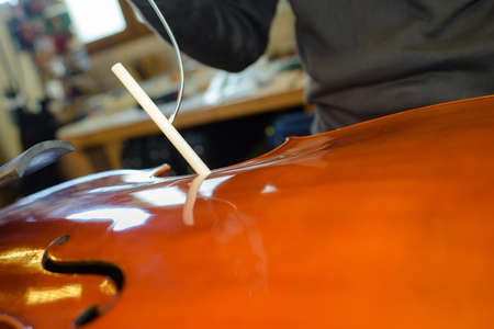 Closeup of violin being made