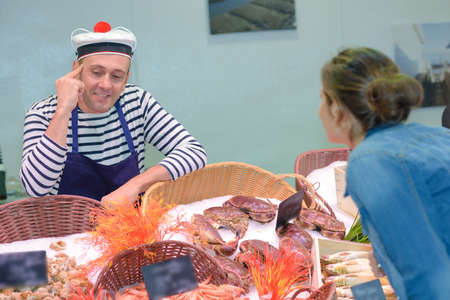 fishmonger: french fishmonger selling fresh fish
