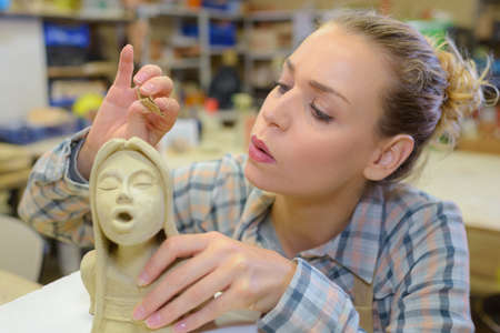clay modeling: artist blowing a statue