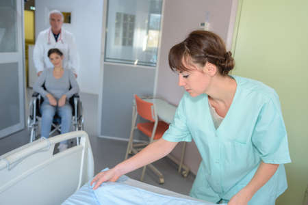 enters: Auxilary preparing bed as patient enters room