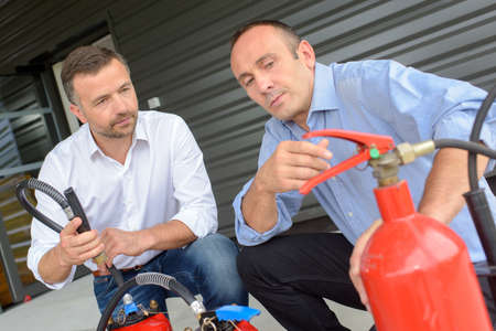 fire extinguishers: salesman explaining differences between fire extinguishers