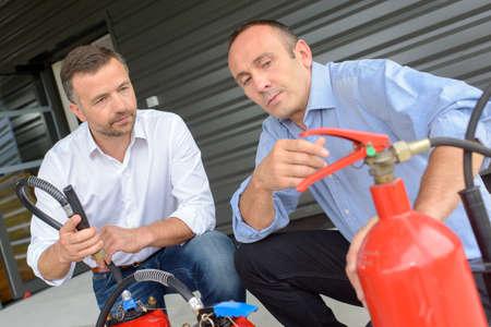 foam safe: salesman explaining differences between fire extinguishers