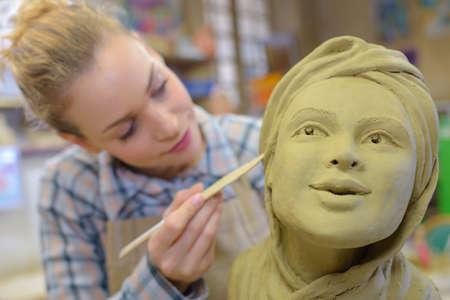 combines: facial detailing of a figurine