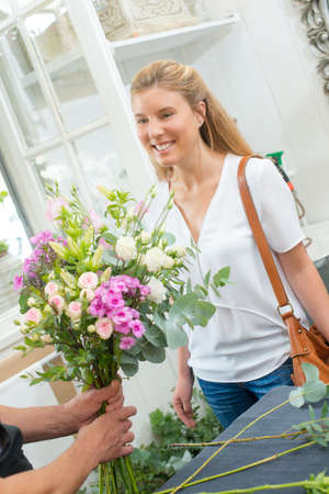 Preparing a bouquet for a customer