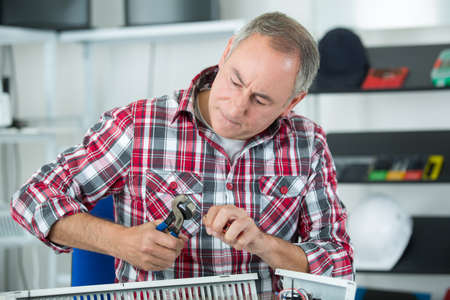 plumber man with tools Stock Photo