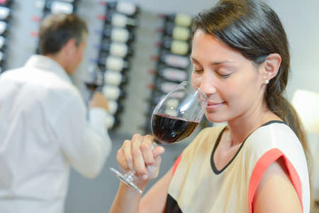 choose person: Brunette smelling a glass of red wine Stock Photo