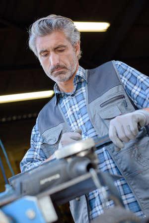 machinery machine: worker doing his job