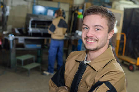 factory worker posing and smiling Stock Photo