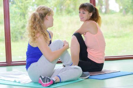 Women in yoga side twist