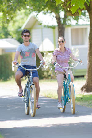 holiday makers riding bikes Stock Photo