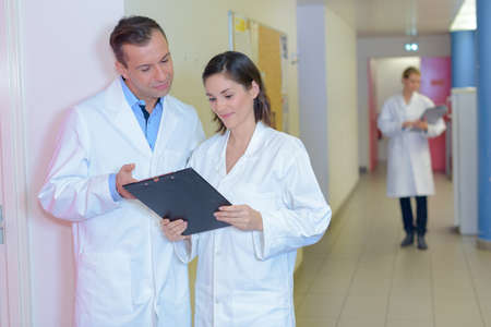 delegation: Male and female nursing staff in discussion Stock Photo