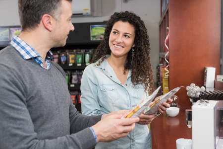 machines: Man and lady looking at coffee pods