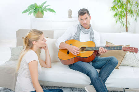 accomplices: Trying to impress his girlfriend by playing guitar