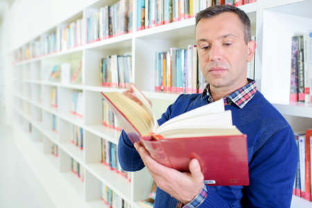 man reading book Stock Photo