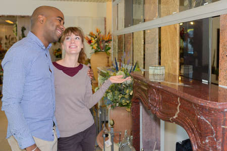 Couple looking at marble fire surround