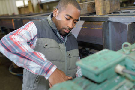 qualified worker: factory worker on the job Stock Photo