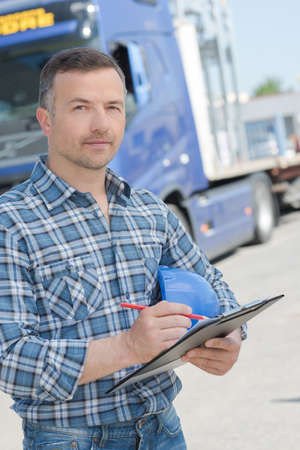 lorry: Portrait of lorry driver with clipboard