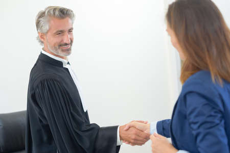 solicitors: judge shaking hands Stock Photo
