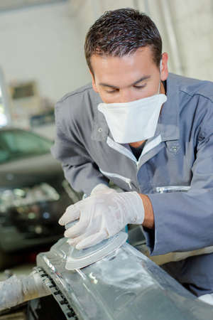 burnish: polishing an automobile part