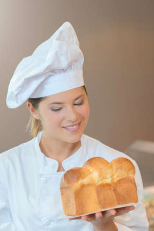 Chef holding loaf of bread Stock Photo