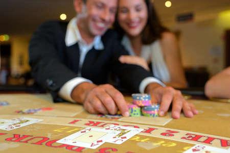gambler: Couple playing at casino table Stock Photo