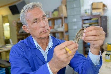 skill: man examinating his creation